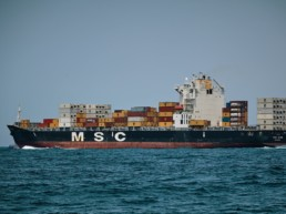 A photo of a container ship at sea